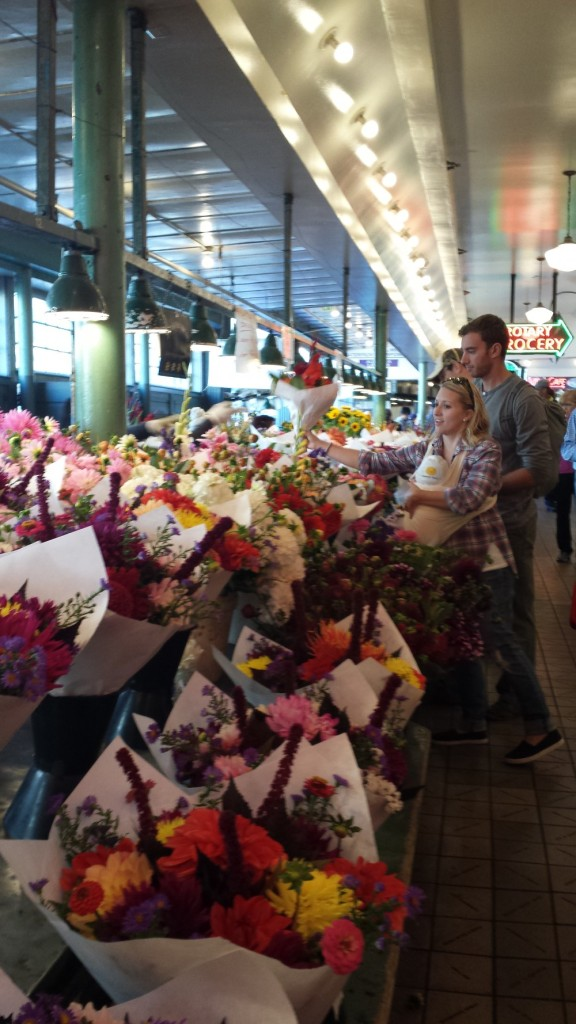 Couple buying flowers at Pike Place Market, Seattle